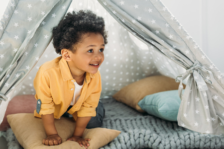 little smiling african american boy in teepee at home Stock Photo