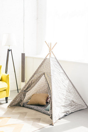 close up view of childish teepee with pillows in room Stock Photo
