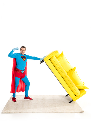 superhero holding couch and showing biceps isolated on white