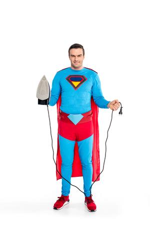 smiling male superhero holding iron and plug isolated on white Imagens - 106810198