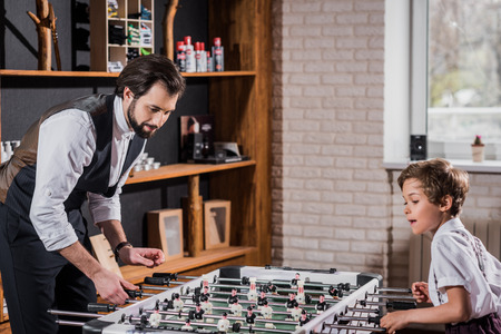 stylish father and son playing table football Stok Fotoğraf