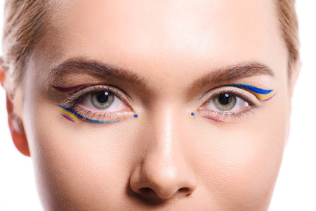cropped image of woman with colored makeup with lines looking at camera isolated on white Banque d'images - 106875540