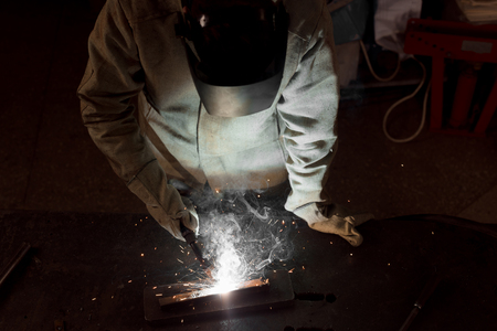 high angle view of worker in protection mask welding metal at factory Stock fotó