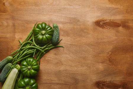 Bell peppers and green beans on wooden table Фото со стока