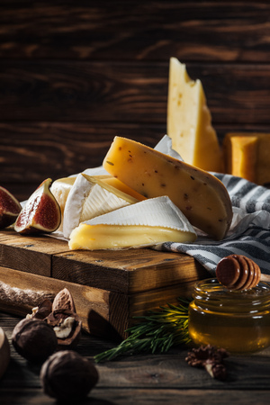 different types of cheeses, honey and fig on table 스톡 콘텐츠