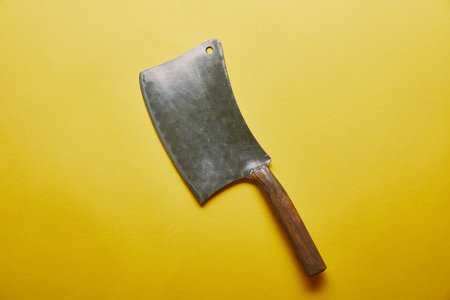 Sharp knife cleaver on yellow background