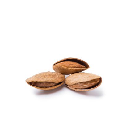 handful of almonds in nutshells isolated on white background Reklamní fotografie