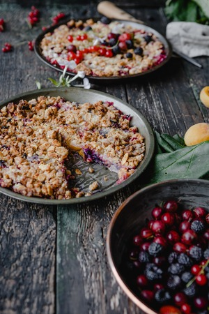 delicious pies with berries on wooden table Stock Photo