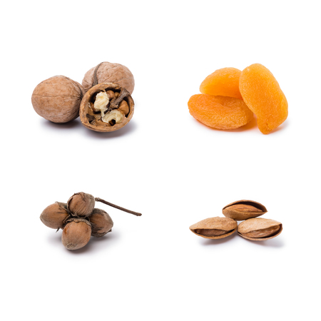 handfuls of assorted nuts and dried apricots isolated on white background