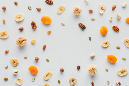 flat lay with delicious dried fruits and nuts with copy space isolated on white background