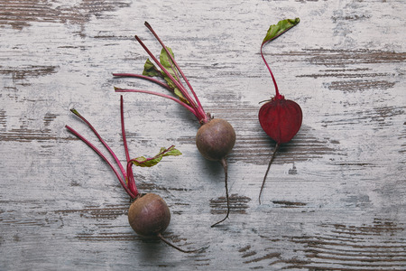 Small red beetroots on rustic wooden table