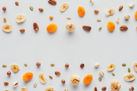 top view of fruits and nuts with copy space isolated on white background