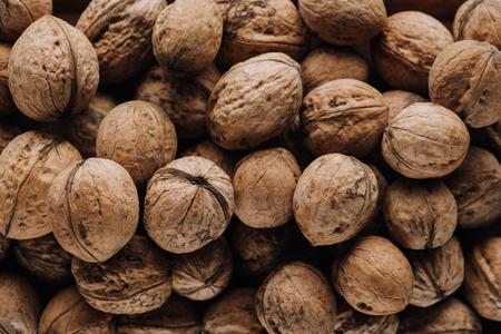 Top view of walnuts in nutshells in full screen