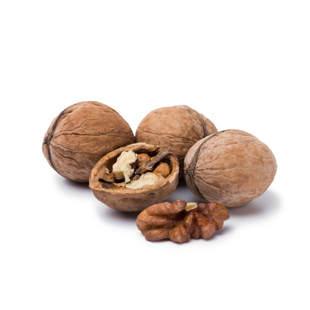 handful of walnuts isolated on white background