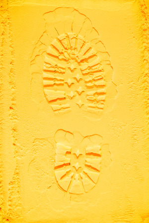 top view of shoe print on yellow powder background Stock Photo - 106891210