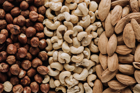 assorted delicious nuts in full screen