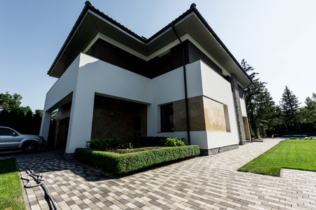 exterior of new modern house with car on parking