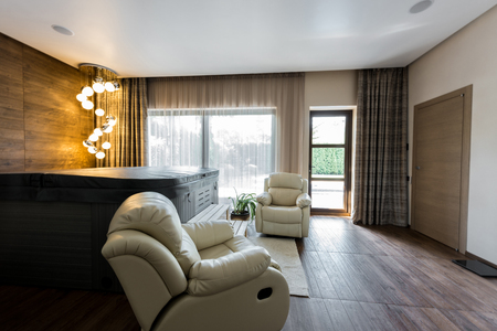 interior of empty modern room with armchairs and closed jacuzzi in spa Фото со стока - 107111091