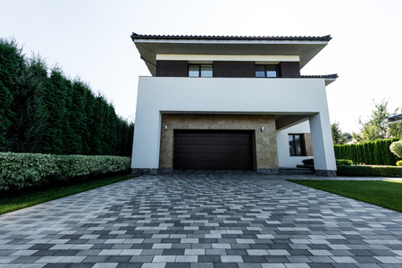 exterior of new modern house with empty parking Stock Photo