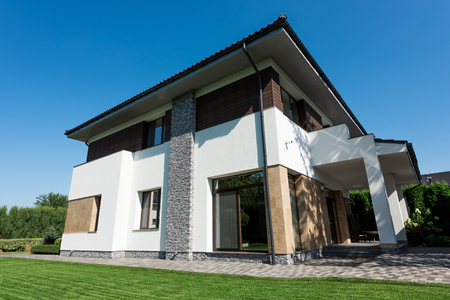 outside view of modern house with green lawn