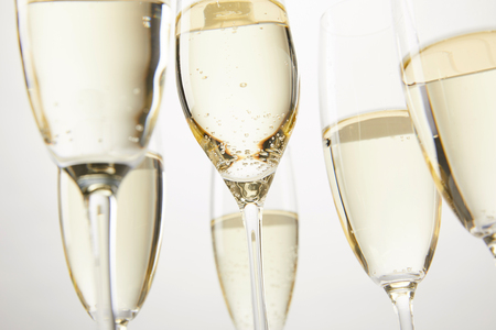 cropped image of champagne glasses with bubbles isolated on white backgronud Stock Photo