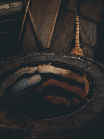 preparation of traditional georgian flatbreads in homemade stove