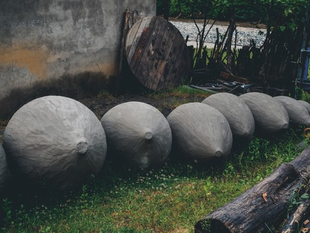 big clay cisterns for producing wine on grass in yard in georgia