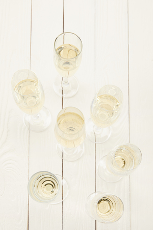 top view of champagne glasses on white wooden table Stock fotó
