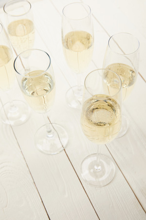 high angle view of champagne glasses on white wooden table Stock fotó