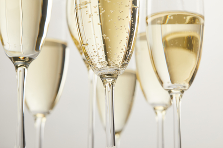 cropped image of champagne glasses with bubbles isolated on white background Stock Photo