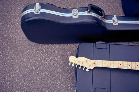 close up view of musical instruments in cases lying on street