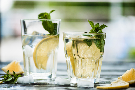 close-up view of fresh cold mojito cocktail in glasses on table