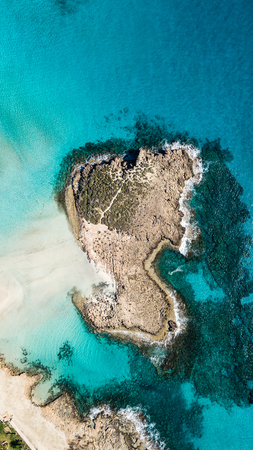 aerial view of empty little island in blue sea, Cyprus