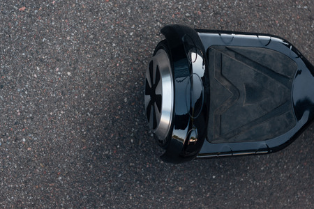 top view of black self-balancing scooter on street Stock Photo