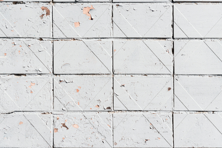 close-up view of old white weathered brick wall textured background