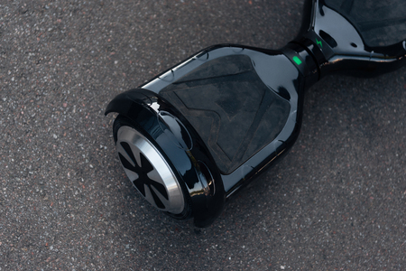 close-up view of black self-balancing scooter on street