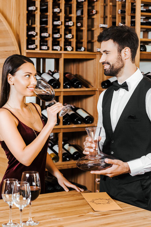 wine steward and client looking at each other during degustation at wine store Stock Photo