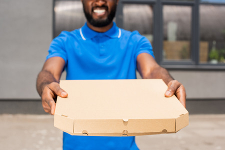 cropped image of african american delivery man showing pizza box
