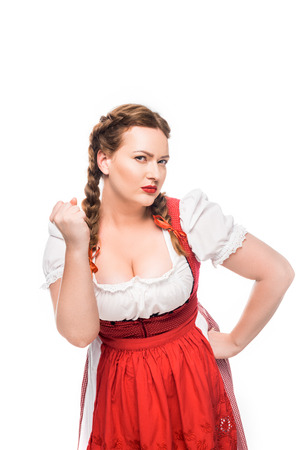 serious oktoberfest waitress in traditional bavarian dress threatening by fist isolated on white background