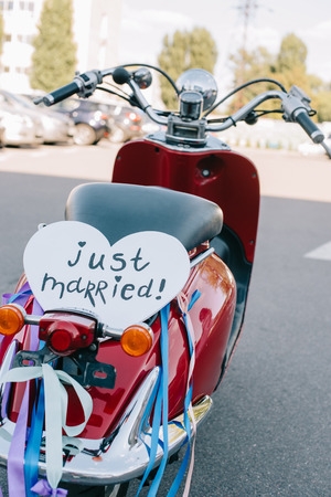 red vintage scooter with ribbons and just married heart symbol for wedding Banco de Imagens