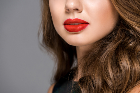 partial view of woman with applied red lipstick on lips isolated on grey Stock fotó