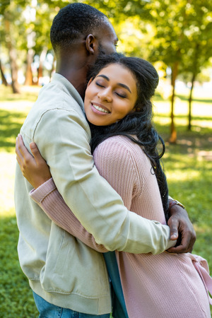 side view of african american couple hugging in park Stock fotó
