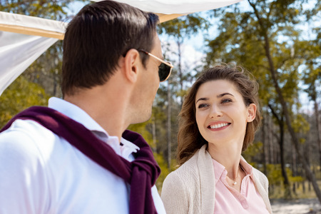 portrait of happy woman looking at husband in sunglasses Stock Photo