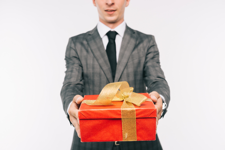 cropped image of businessman showing gift box isolated on white Stock Photo