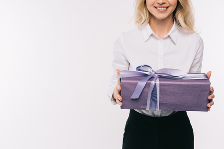cropped image of smiling businesswoman holding gift box isolated on white