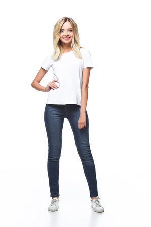 smiling attractive girl posing in white shirt and jeans isolated on white