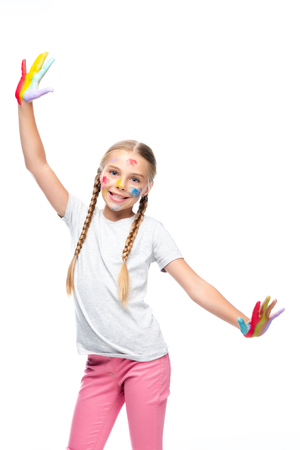 smiling schoolchild standing with painted open arms isolated on white