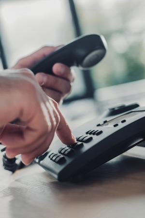 cropped shot of man making phone dial Stock fotó - 107912258