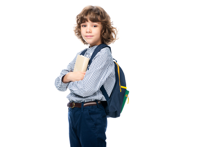 schoolboy hugging book and looking at camera isolated on white
