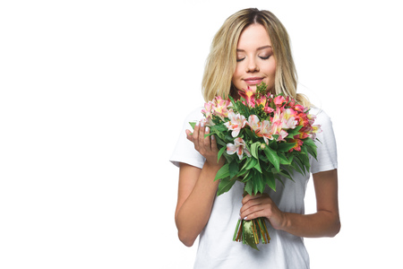 attractive girl in white shirt sniffing bouquet of flowers with closed eyes isolated on white Imagens - 107913134